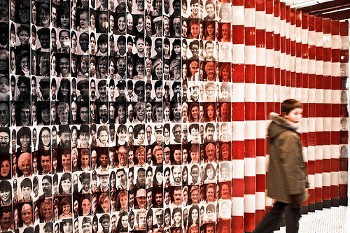 immigrant faces make the American flag at Ellis Island